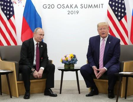 Russia's President Vladimir Putin and U.S. President Donald Trump attend a meeting on the sidelines of the G20 summit in Osaka