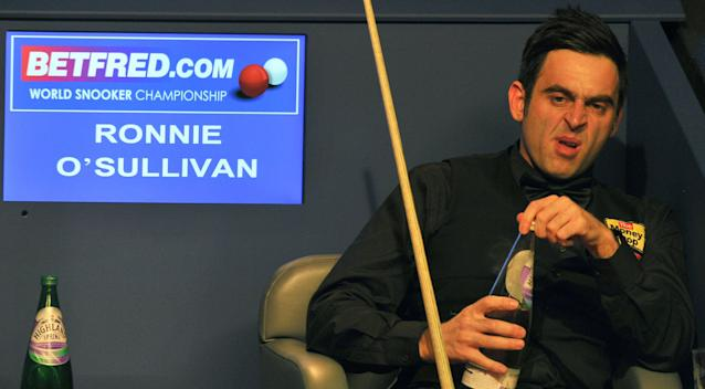 Ronnie O'Sullivan of England watches as Ali Carter of England plays a shot during the second session of the World Championship Snooker final at the Crucible Theatre in Sheffield, on May 7, 2012. AFP PHOTO/PAUL ELLISPAUL ELLIS/AFP/GettyImages