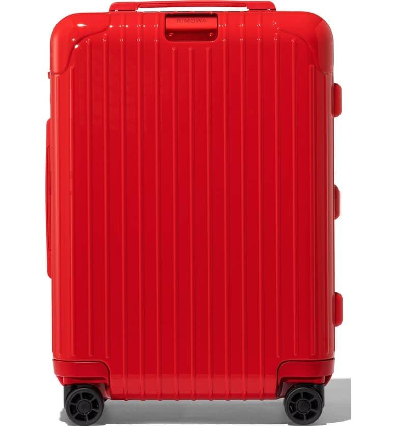 """<p>This bright red <a href=""""https://www.popsugar.com/buy/Rimowa-Essential-Cabin-22-Inch-Packing-Case-403556?p_name=Rimowa%20Essential%20Cabin%2022-Inch%20Packing%20Case&retailer=shop.nordstrom.com&pid=403556&price=700&evar1=travel%3Aus&evar9=45654068&evar98=https%3A%2F%2Fwww.popsugar.com%2Ftravel%2Fphoto-gallery%2F45654068%2Fimage%2F45654072%2FRimowa-Essential-Cabin-22-Inch-Packing-Case&list1=shopping%2Ctravel%2Cbags%2Cluggage%2Csuitcases%2Ctravel%20style&prop13=api&pdata=1"""" rel=""""nofollow"""" data-shoppable-link=""""1"""" target=""""_blank"""" class=""""ga-track"""" data-ga-category=""""Related"""" data-ga-label=""""https://shop.nordstrom.com/s/rimowa-essential-cabin-22-inch-packing-case/5102637?origin=category-personalizedsort&amp;breadcrumb=Home%2FHome%20%26%20Gifts%2FHome%2FLuggage%20%26%20Travel&amp;color=red"""" data-ga-action=""""In-Line Links"""">Rimowa Essential Cabin 22-Inch Packing Case</a> ($700) will ensure that nobody mistakes your carry-on for theirs.</p>"""