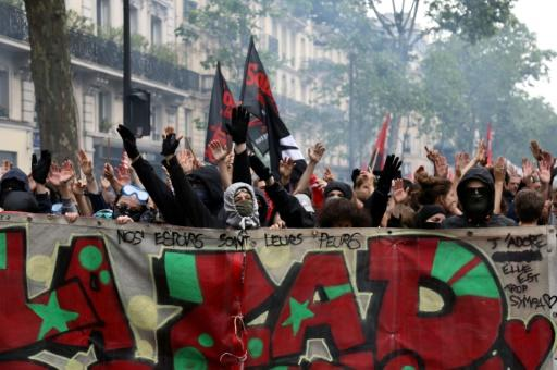 Public-sector workers on strike fear Macron's pledge to reduce spending, trim jobs and overhaul large parts of the vast French state