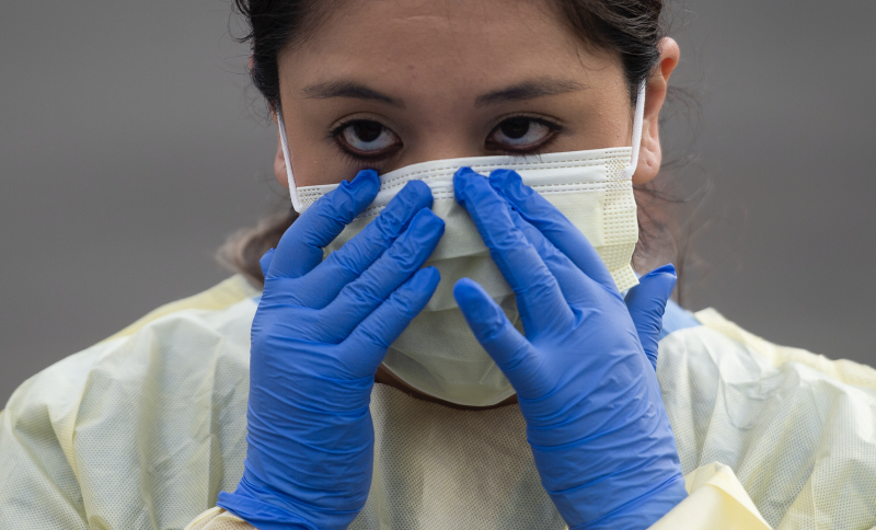 Health care workers from Virginia Hospital Center put on their personal protective equipment before people arrive at a drive through testing site for coronavirus in Arlington, Virginia. on March 20, 2020. (Photo: ANDREW CABALLERO-REYNOLDS / AFP)