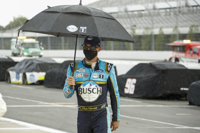 "<a class=""link rapid-noclick-resp"" href=""/nascar/sprint/drivers/205/"" data-ylk=""slk:Kevin Harvick"">Kevin Harvick</a> walks down pit road during a weather delay during the NASCAR Cup Series auto race at Pocono Raceway, Sunday, June 28, 2020, in Long Pond, Pa. (AP Photo/Matt Slocum)"