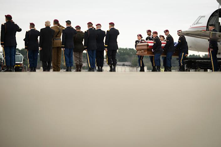The remains of Staff Sgt. Ian Paul McLaughlin are carried from a plane to an awaiting hearse on Fort Bragg, N.C., on Saturday, Jan. 18, 2020. McLaughlin was killed Jan. 11 in Afghanistan.