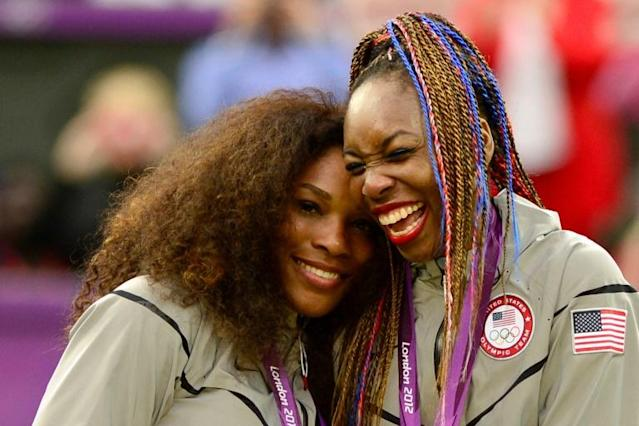 Sisters: Serena and Venus Williams celebrate women's doubles gold in London in 2012 (AFP Photo/LEON NEAL)