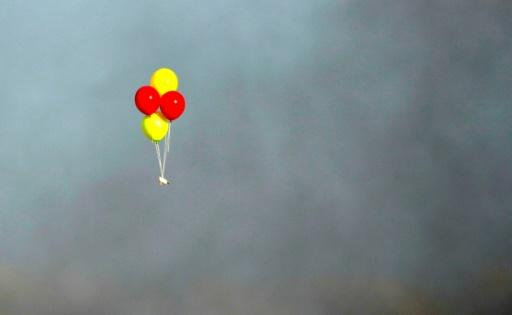 Balloons loaded with incendiaries are flown towards Israel during a confrontation between Palestinian demonstrators and Israeli troops east of Gaza City, along the border between the Gaza strip and Israel, on July 13, 2018