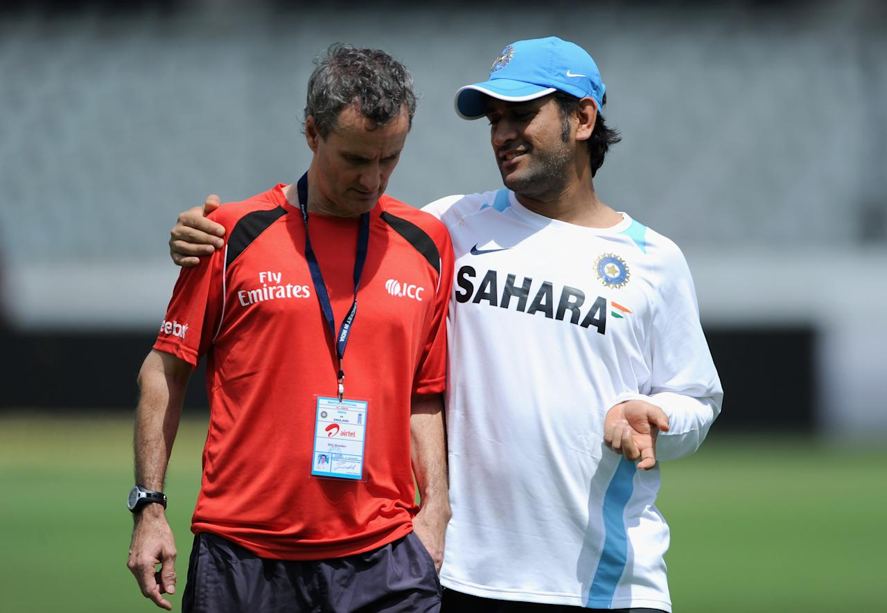 HYDERABAD, INDIA - OCTOBER 13:  India captain MS Dhoni speaks with umpire Billy Bowden during a nets session at The Rajiv Gandhi International Cricket Stadium on October 13, 2011 in Hyderabad, India.  (Photo by Gareth Copley/Getty Images)