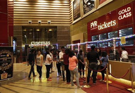 Cinema-goers wait to collect their tickets at a PVR Multiplex in Mumbai November 10, 2013. REUTERS/Danish Siddiqui