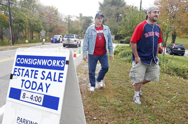 Stuart Patrick, left, and his son Mike Patrick, right, enter the estate sale at the home of Curt Schilling in Medfield, Mass., Saturday, Oct. 12, 2013. Rhode Island's economic development agency is suing Schilling over the collapse of the video game company he founded, 38 Studios, which later went bankrupt. (AP Photo/Stew Milne)