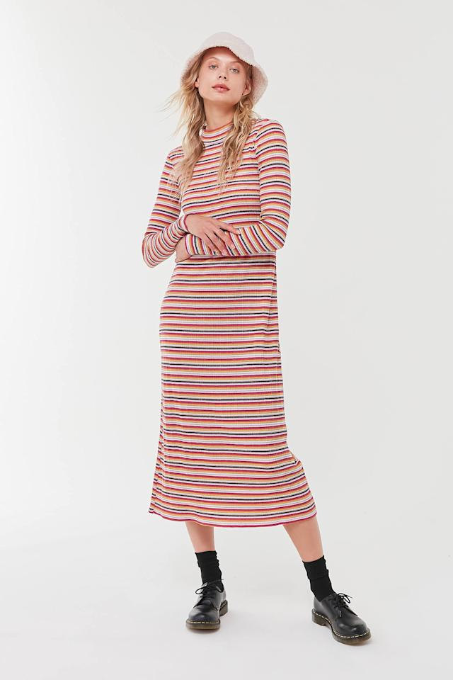 """<p>This <a href=""""https://www.popsugar.com/buy/UO-Corinne-Striped-Knit-Midi-Dress-490347?p_name=UO%20Corinne%20Striped%20Knit%20Midi%20Dress&retailer=urbanoutfitters.com&pid=490347&price=79&evar1=fab%3Aus&evar9=44705274&evar98=https%3A%2F%2Fwww.popsugar.com%2Ffashion%2Fphoto-gallery%2F44705274%2Fimage%2F46614772%2FUO-Corinne-Striped-Knit-Midi-Dress&list1=shopping%2Ctravel%2Cfall%20fashion%2Cdresses%2Cfall%2Cspring%2Csummer%2Cday%20dresses%2Ctravel%20style%2Cspring%20fashion%2Csummer%20fashion%2Cspring%20dresses&prop13=mobile&pdata=1"""" rel=""""nofollow"""" data-shoppable-link=""""1"""" target=""""_blank"""" class=""""ga-track"""" data-ga-category=""""Related"""" data-ga-label=""""https://www.urbanoutfitters.com/shop/uo-corinne-striped-knit-midi-dress?category=dresses&amp;color=095&amp;type=REGULAR"""" data-ga-action=""""In-Line Links"""">UO Corinne Striped Knit Midi Dress</a> ($79) will never wrinkle in your suitcase.</p>"""