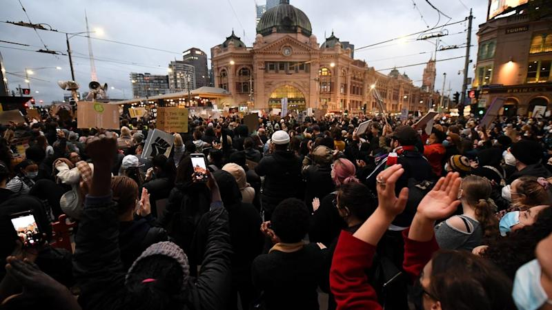 It is unlikely that two protesters caught COVID-19 at a rally in Melbourne, a health offical says