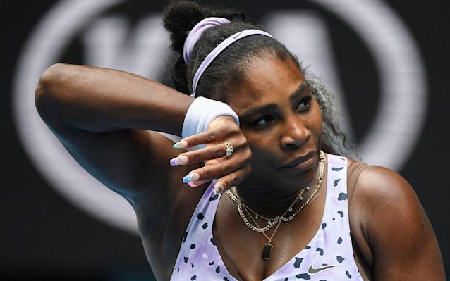 Serena Williams of the US reacts after a point against China's Wang Qiang during their women's singles match on day five of the Australian Open - AFP