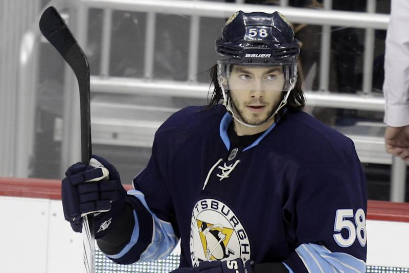 This is a Feb. 11, 2012, file photo showing Pittsburgh Penguins' Kris Letang (58)  during an NHL hockey game against the Winnipeg Jets in Pittsburgh. Letang will be out for six-plus weeks after having a stroke. Penguins general manager Ray Shero announced Friday, Feb. 7, 2014,  that Letang had a stroke last week