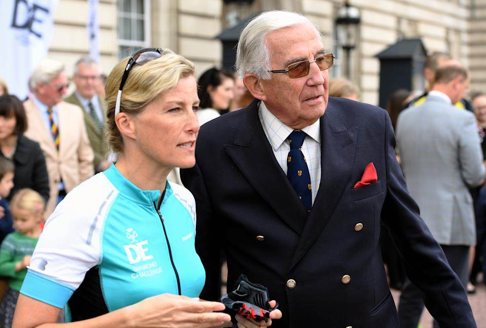 LONDON, ENGLAND - SEPTEMBER 25:  Sophie, Countess of Wessex stands beside her father Christopher Rhys-Jones in the forecourt of Buckingham Palace after receiving her Diamond Award for biking from Edinburgh to London in support of The Duke of Edinburgh's Award on September 25, 2016 in London, England.  The Countess and the other riders were presented with a Diamond Pin to mark the completion of the Diamond Challenge. The Countess of Wessex cycled 445 miles from the Palace of Holyroodhouse, Edinburgh to Buckingham Palace, London over seven days as her 'Diamond Challenge' - a special initiative marking the 60th anniversary of the Duke of Edinburgh's Award. (Photo by Anwar Hussein/WireImage)