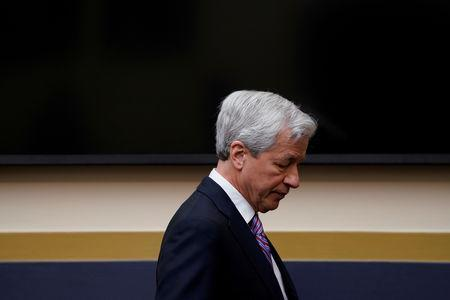 "FILE PHOTO: Jamie Dimon, chairman & CEO of JP Morgan Chase & Co., arrives to testify before a House Financial Services Committee hearing on ""Holding Megabanks Accountable: A Review of Global Systemically Important Banks 10 Years After the Financial Crisis"" on Capitol Hill in Washington, U.S., April 10, 2019. REUTERS/Aaron P. Bernstein/File Photo"