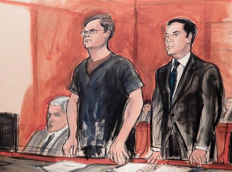 In this courtroom drawing, defendant Evgeny Buryakov stands with his attorney Scott Hershman during sentencing on espionage charges in New York on May 25, 2016. (AP Photo/Elizabeth Williams)