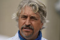 Trainer Steve Asmussen talks to the media after workouts at Churchill Downs Wednesday, April 28, 2021, in Louisville, Ky. Asmussen has two horses, Midnight Bourbon and Super Stock, entered in the 147th running of the Kentucky Derby on Saturday, May 1. (AP Photo/Charlie Riedel)