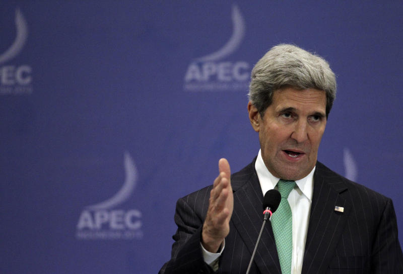 "U.S. Secretary of State John Kerry speaks during a press conference at the Asia-Pacific Economic Cooperation (APEC) summit in Bali, Indonesia, Saturday, Oct. 5, 2013. Kerry on Saturday urged Congress to end the partial government shutdown and think ""long and hard"" about the message U.S. sends the world when ""we can't get our own act together."" (AP Photo/Wong Maye-E)"