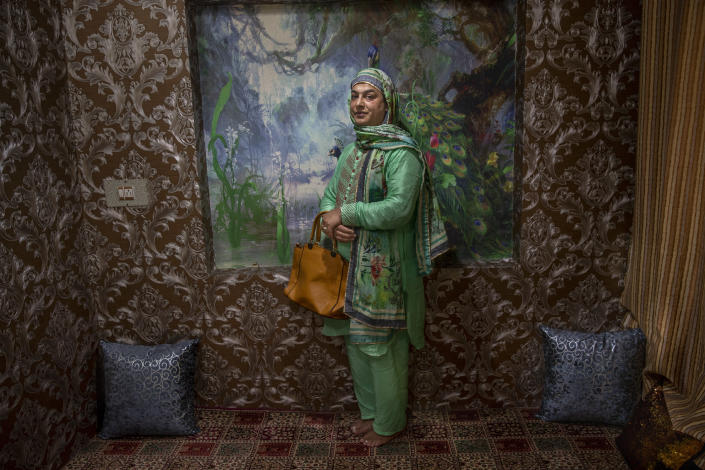 """Mehak Mir, a transgender Kashmiri, stands for a photograph at home in Srinagar, Indian controlled Kashmir, Thursday, June 3, 2021. Mir is a prominent figure among the transgender community in Kashmir as a match-maker and performer. """"Marriage is once in a lifetime event and without us it is incomplete. I hope this pandemic ends soon and we will bring joy and happiness in the lives of people once again,"""" she said. (AP Photo/ Dar Yasin)"""