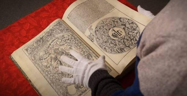 Athol Murray College of Notre Dame's copy of the Nuremberg Chronicle, one of many rare books in the school's collection. (Notre Dame Hounds/YouTube - image credit)