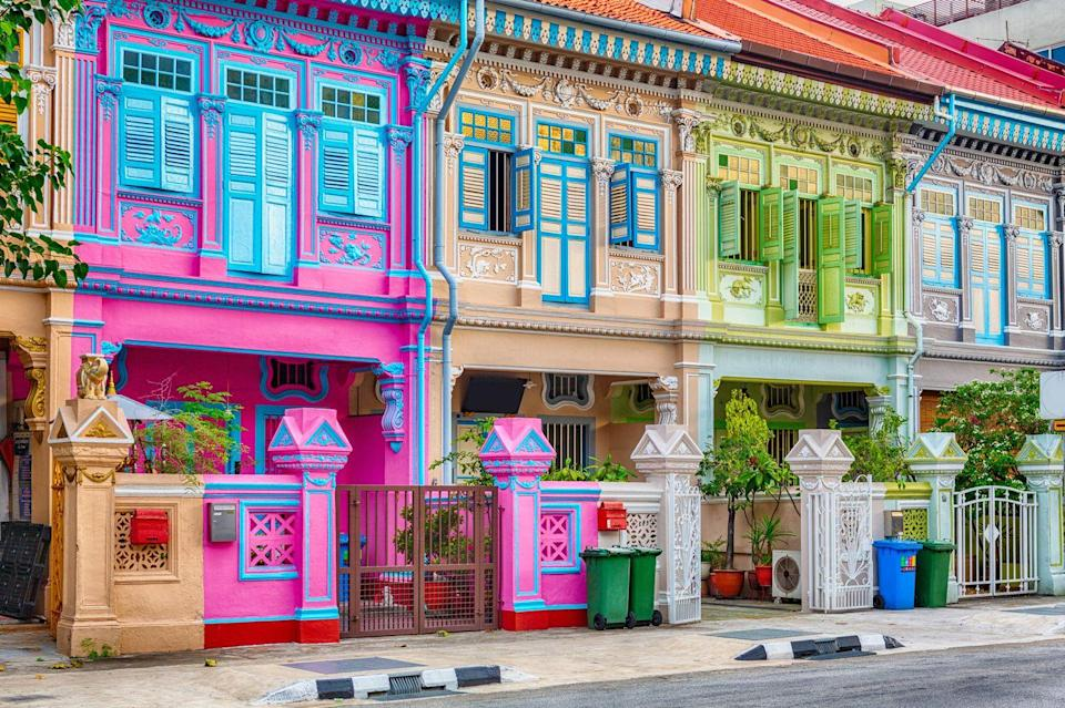 <p>Just off the main road in the Katong area of Singapore lies a candy-colored wonderland celebrating the rich culture and traditions of the Peranakan people. The history of Singapore's Peranakan culture dates back to the 15th century, when Chinese immigrants began settling in then-Malaya and worked as traders. </p><p> As the area became more developed, merchants began showcasing their wealth in the form of colorful motifs and intricate tilework decorating their shophouses. The row of flamboyant homes on Koon Seng Road are often referred to as the Painted Ladies by locals.</p>