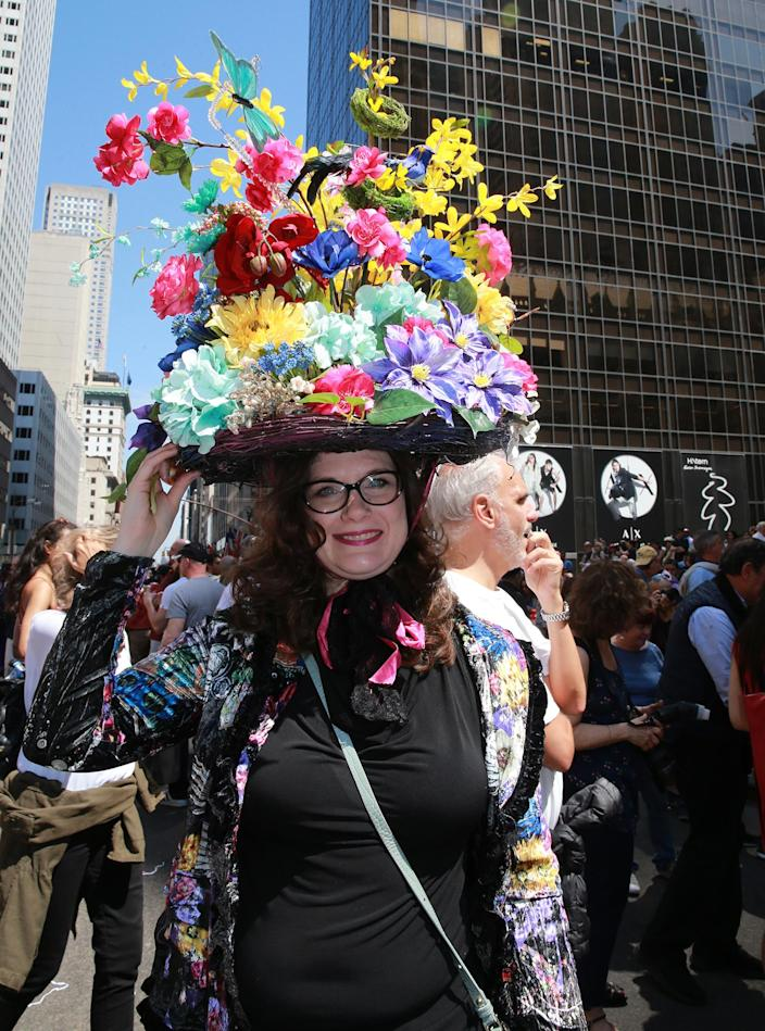 <p>Heather Crane-Precosky from Madison Wis.,shows off a colorful arrangement during the 2017 New York City Easter Parade on April 16, 2017. (Photo: Gordon Donovan/Yahoo News) </p>