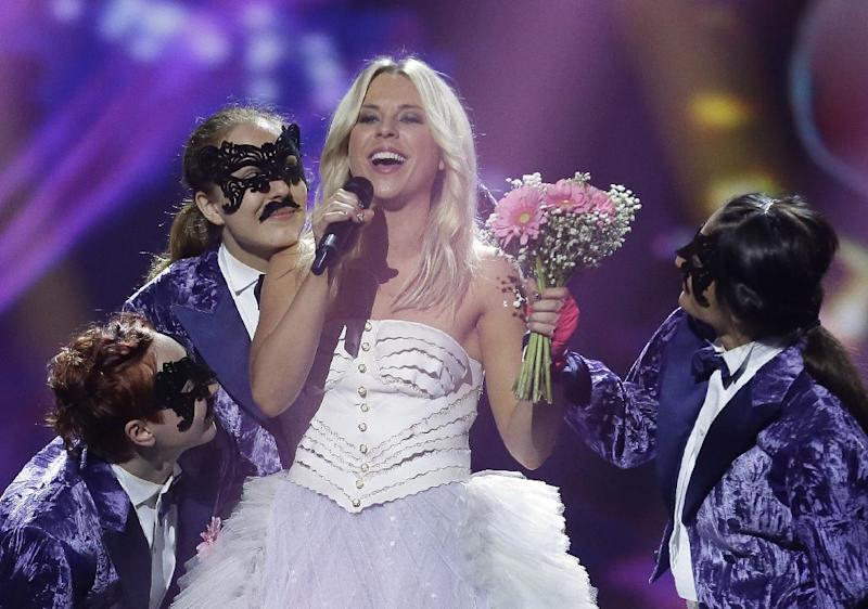 "Krista Siegfrids, of Finland performs her song ""Marry Me"" during a rehearsal for the final of the Eurovision Song Contest at the Malmo Arena in Malmo, Sweden, Friday, May  17, 2013. The contest is run by European television broadcasters with the event being held in Sweden as they won the competition in 2012, the final will be held in Malmo on May 18. (AP Photo/Alastair Grant)"