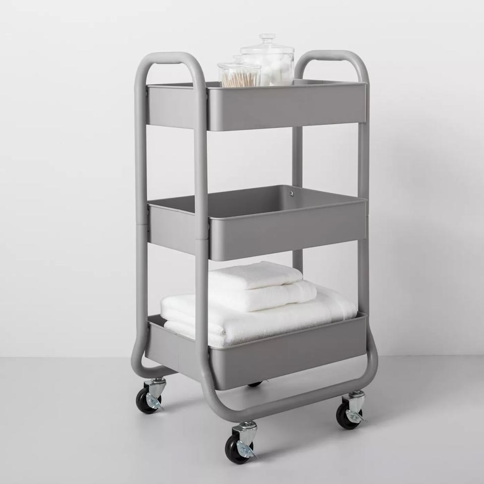 """<p>Perfect for small spaces (especially dorms), the <a href=""""https://www.popsugar.com/buy/3-Tier-Metal-Utility-Cart-474936?p_name=3-Tier%20Metal%20Utility%20Cart&retailer=target.com&pid=474936&price=35&evar1=casa%3Auk&evar9=46443084&evar98=https%3A%2F%2Fwww.popsugar.com%2Fhome%2Fphoto-gallery%2F46443084%2Fimage%2F46447384%2F3-Tier-Metal-Utility-Cart&list1=target%2Cfurniture&prop13=api&pdata=1"""" rel=""""nofollow"""" data-shoppable-link=""""1"""" target=""""_blank"""" class=""""ga-track"""" data-ga-category=""""Related"""" data-ga-label=""""https://www.target.com/p/3-tier-metal-utility-cart-made-by-design-153/-/A-53314604?preselect=53166281#lnk=sametab"""" data-ga-action=""""In-Line Links"""">3-Tier Metal Utility Cart</a> ($35) can hold coffee makers, kitchen products, bathroom supplies, and more. </p>"""