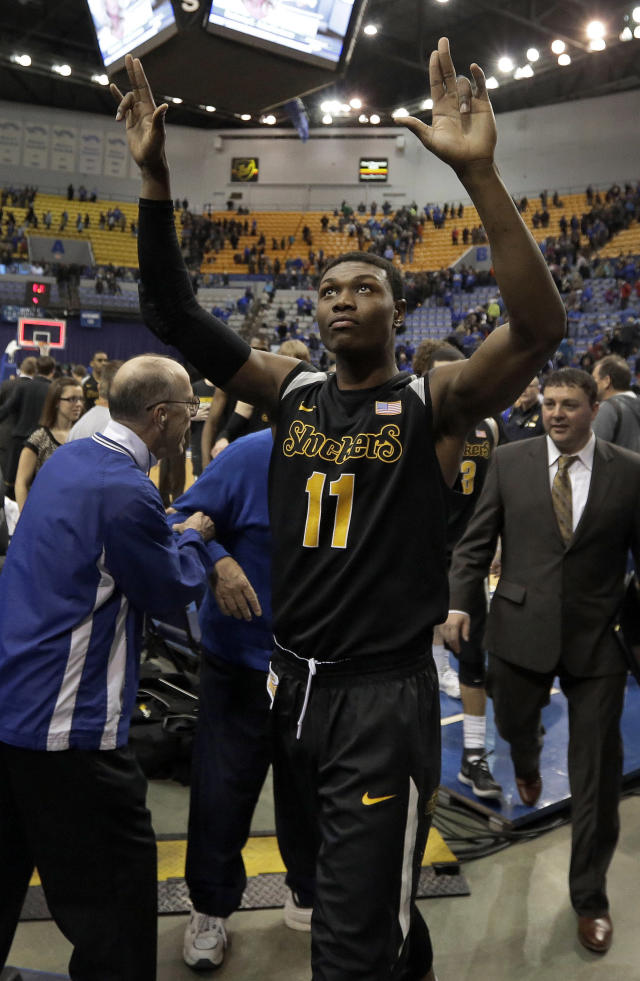 Wichita State forward Cleanthony Early (11) gestures to the crowd after an NCAA college basketball game against Indiana State in Terre Haute, Ind., Wednesday, Feb. 5, 2014. Wichita State won 65-58. (AP Photo/AJ Mast)