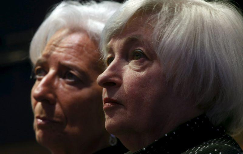 Yellen and Lagarde listen to opening remarks at the IMF in Washington