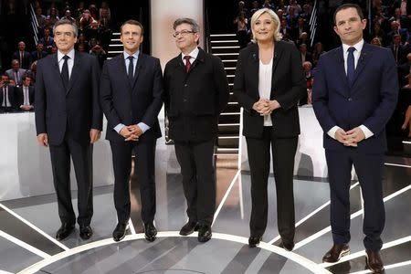 French presidential election candidates Francois Fillon, Emmanuel Macron, Jean-Luc Melenchon, Marine Le Pen and Benoit Hamon, pose before a debate organised by French private TV channel TF1 in Aubervilliers