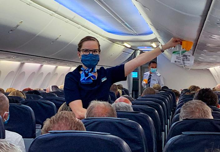 Masked stewardess on flight from Duesseldorf to Mallorca on June 15, 2020.