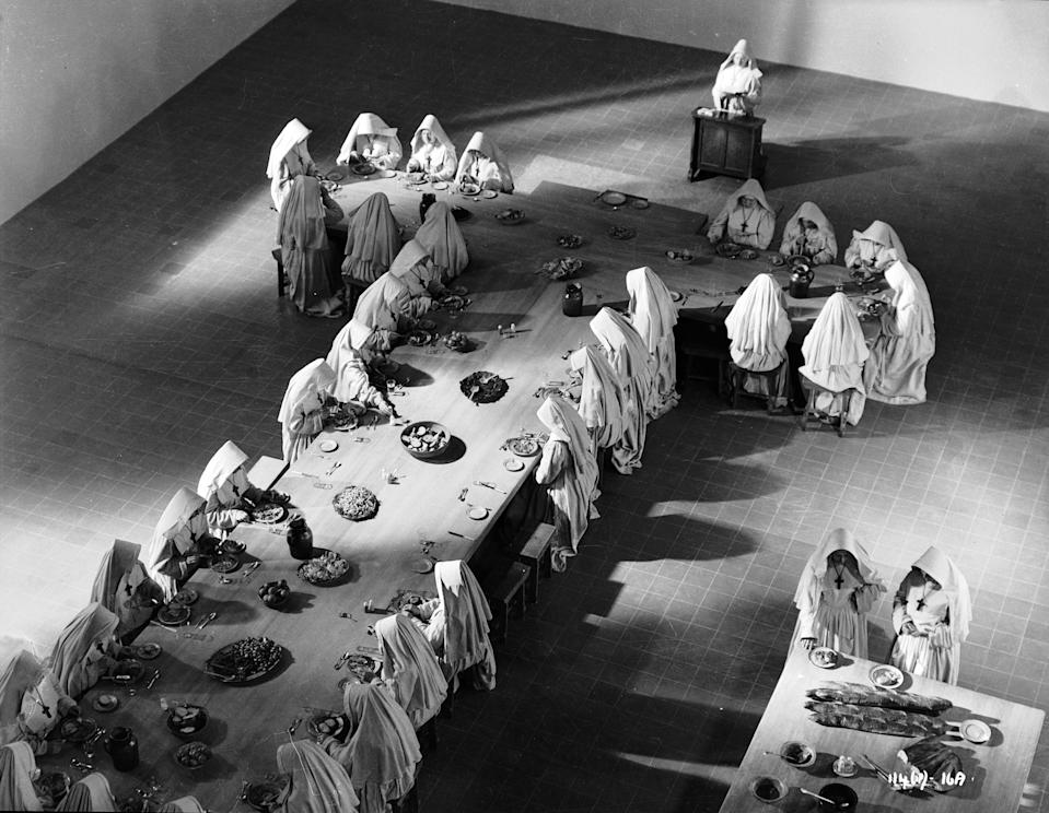 1947:  The Anglican nuns sit down to a meal in their Himalayan community in a scene from 'Black Narcissus', directed by Michael Powell and Emeric Pressburger.  (Photo via John Kobal Foundation/Getty Images)