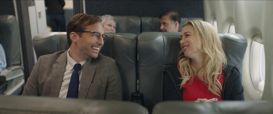 """This image released by Netflix shows Ryan Hansen, left, and Iliza Schlesinger in a scene from """"Good On Paper."""" (Netflix via AP)"""