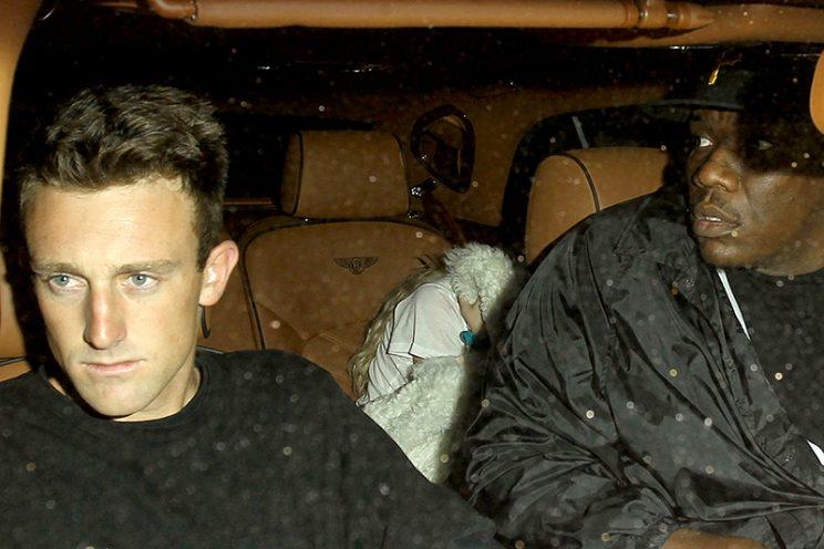 Bella Thorne tries to hide while leaving the Peppermint Club with Scott Disick. (Photo: Backgrid)
