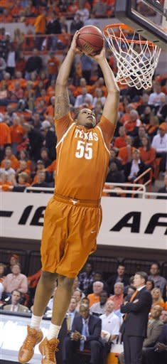 Texas center Cameron Ridley dunks during the first half of an NCAA college basketball game against Oklahoma State in Stillwater, Okla., Saturday, March 2, 2013. (AP Photo/Brody Schmidt)