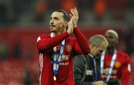 Manchester United's Zlatan Ibrahimovic applauds fans as he celebrates winning the EFL Cup Final
