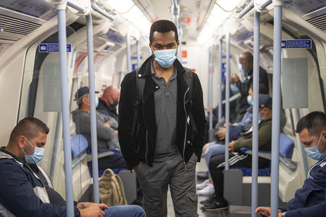Passengers wear masks on the London underground. (Getty Images)