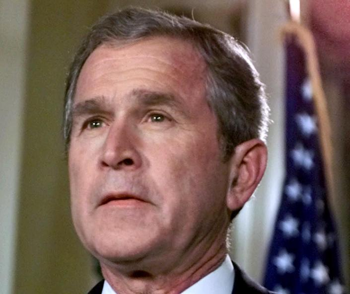 """FILE - In this Nov. 15, 2000 file photo, then-Republican presidential candidate, Texas Gov. George W. Bush prepares to make a statement from the governor's mansion in Austin, Texas, concerning the Florida vote count. The mere mention of the 2000 election unsettles people in Palm Beach County. The county's poorly designed """"butterfly ballot"""" confused thousands of voters, arguably costing Democrat Al Gore the state, and thereby the presidency. Gore won the national popular vote by more than a half-million ballots. But George W. Bush became president after the Supreme Court decided, 5-4, to halt further Florida recounts, more than a month after Election Day. Bush carried the state by 537 votes, enough for an Electoral College edge, and the White House. (AP Photo/Eric Gay, File)"""