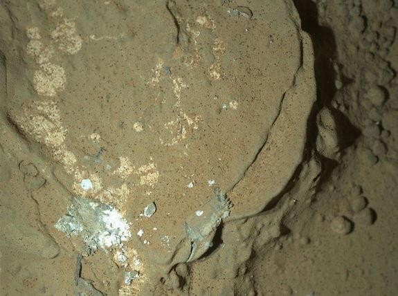 This image of a Martian rock illuminated by white-light LEDs (light emitting diodes) is part of the first set of nighttime images taken by the Mars Hand Lens Imager (MAHLI) camera at the end of the robotic arm of NASA's Mars rover Curiosity. MA