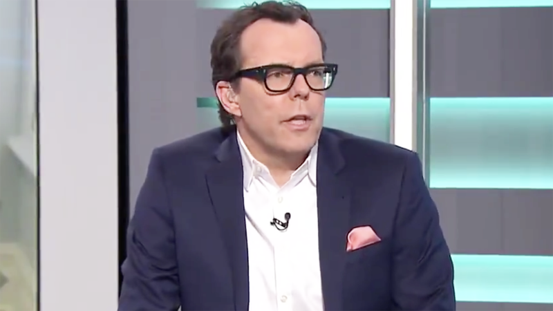 Damian Barrett is pictured speaking during Channel 9's Sunday Footy Show.