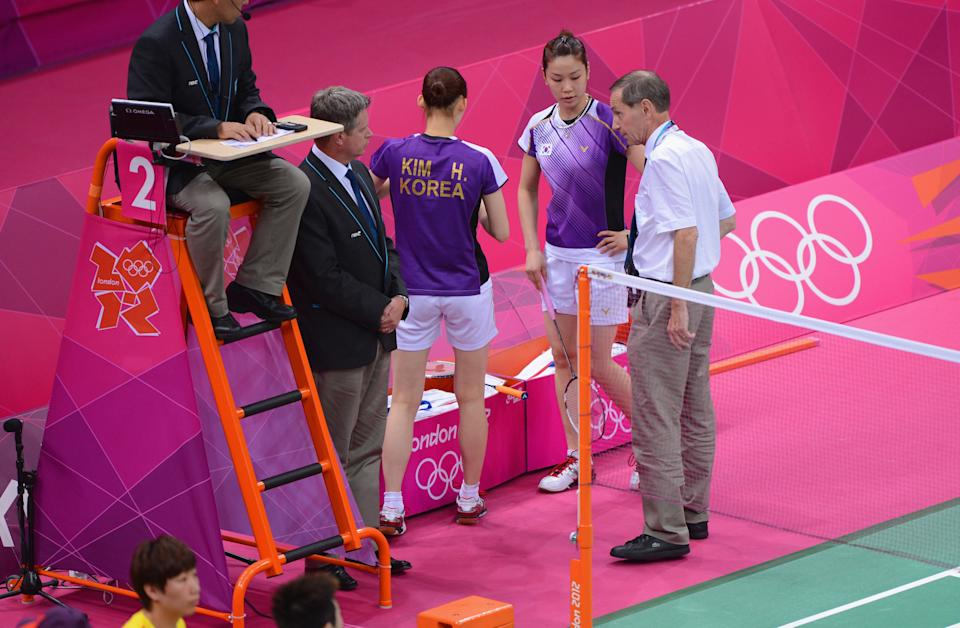 LONDON, ENGLAND - JULY 31: An official speaks with Jung Eun Ha and Min Jung Kim of Korea during their Women's Doubles Badminton match on Day 4 of the London 2012 Olympic Games at Wembley Arena on July 31, 2012 in London, England. (Photo by Michael Regan/Getty Images)