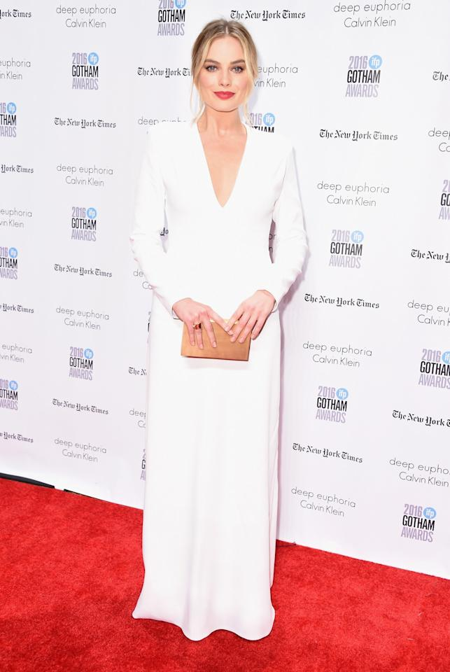 <p>The Australian star looked stunning in a white long-sleeved gown with a plunging neckline. (Photo: Getty Images) </p>