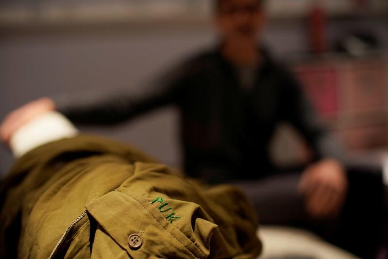 The Patriotic Union of Kurdistan (PUK) uniform of Mark Giaconia, who served for 20 years in the U.S. Army, of which 15 years in the U.S. Special Forces and was embedded with the Kurds in Iraq, is seen at his house in Herndon