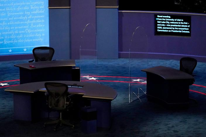The stage is set with glass between seats ahead of the vice presidential debate at the University of Utah, Wednesday in Salt Lake City.