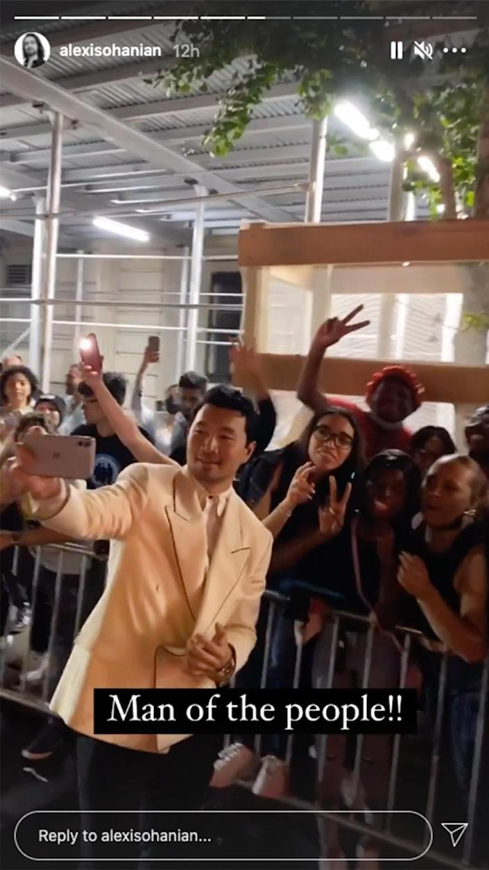 <p>Simu Liu greeted the hundreds of fans gathered outside of the museum, in a photo captured by Alexis Ohanian. </p>