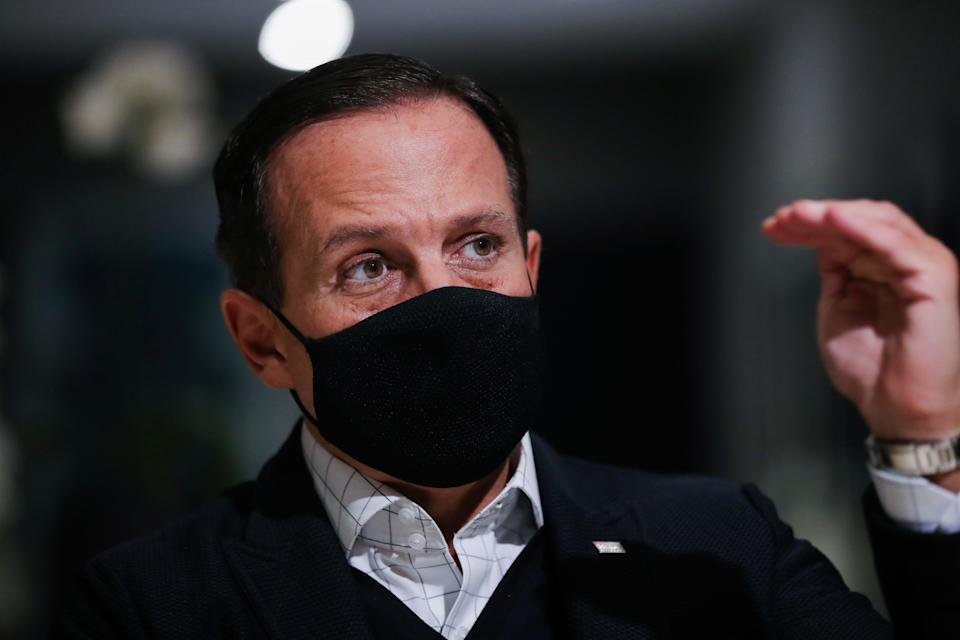 Brazil's Sao Paulo state governor Joao Doria, wearing a protective mask, gestures during an interview with Reuters at Palacio dos Bandeirantes, the seat of the Sao Paulo State Government in Sao Paulo, Brazil April 20, 2021. Picture taken April 20, 2021. REUTERS/Amanda Perobelli