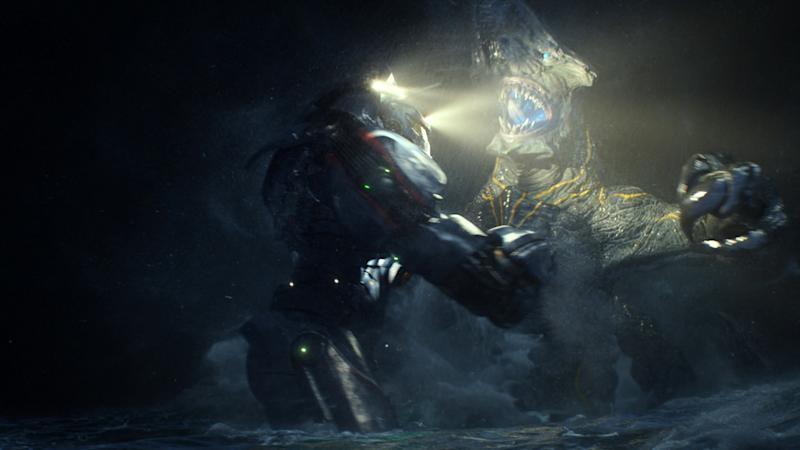"This film publicity image released by Warner Bros. Pictures shows the Gipsy Danger robot battling the Knifehead monster in a scene from ""Pacific Rim."" (AP Photo/Warner Bros. Pictures)"