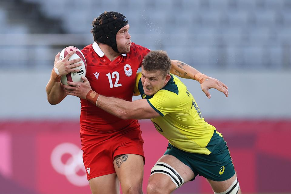 Pictured here, Australia's Nick Malouf tackles a player from Canada at the Olympic Games.