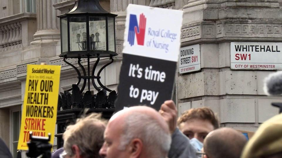 Health workers in Downing Street (PA Video/PA) (PA Wire)