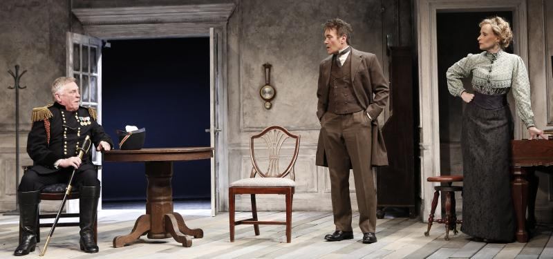 """This theater publicity image released by David Gersten & Associates shows, from left, Daniel Davis, Derek Smith, and Laila Robins in a scene from the Red Bull Theater adaptation of August Strindberg's """"Dance of Death"""", currently performing off-Broadway at the Lucille Lortel Theatre in New York. (AP Photo/David Gersten & Associates, Carol Rosegg)"""